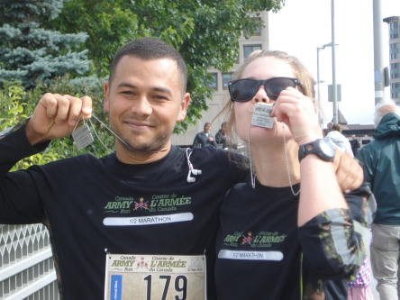 Me and my running newbie congratulate ourselves. Omar finished about 30 minutes faster than me, but stuck around in true Running Room fashion